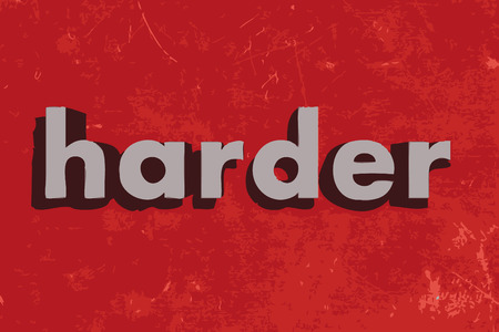 harder: harder word on red concrete wall