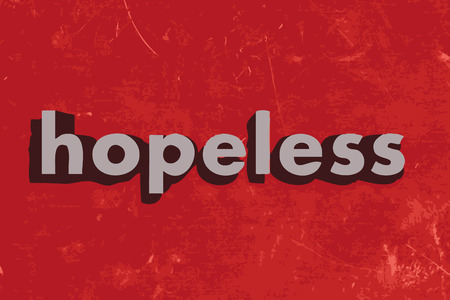 hopelessness: hopeless word on red concrete wall
