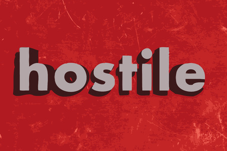hostile: hostile word on red concrete wall
