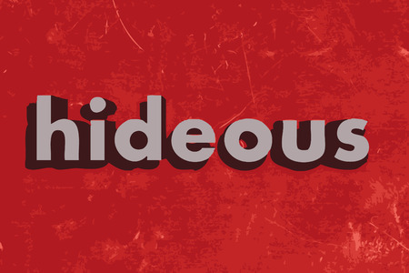 hideous: hideous word on red concrete wall