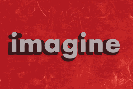 imagine word on red concrete wall