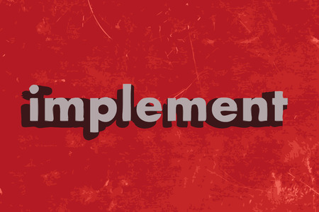 implement word on red concrete wall