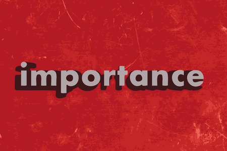 importance: importance word on red concrete wall Illustration