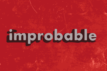improbable: improbable word on red concrete wall