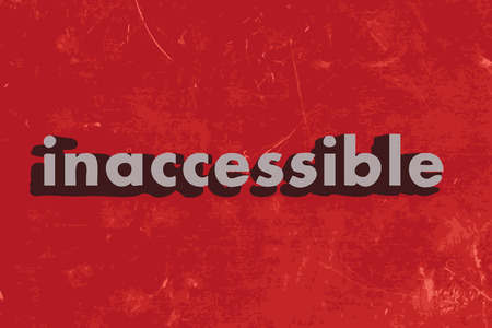 inaccessible: inaccessible word on red concrete wall