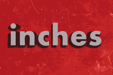 inches: inches word on red concrete wall