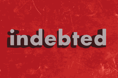 indebted: indebted word on red concrete wall