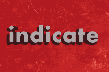 indicate: indicate word on red concrete wall