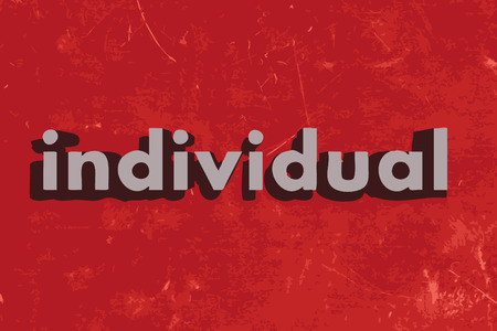 individual: individual word on red concrete wall