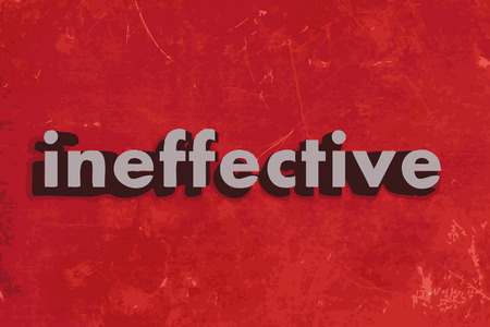ineffective: ineffective word on red concrete wall