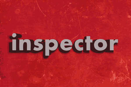 inspector: inspector word on red concrete wall