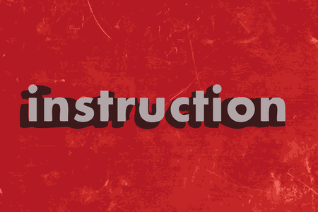 instruction: instruction word on red concrete wall