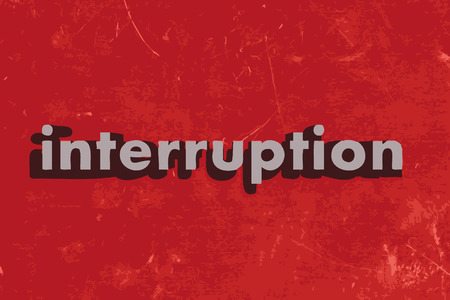 interruption: interruption word on red concrete wall