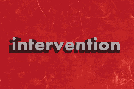 intervention: intervention word on red concrete wall