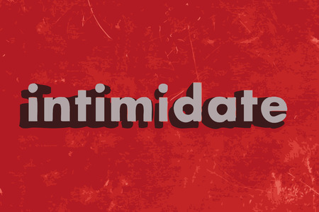 intimidate: intimidate word on red concrete wall