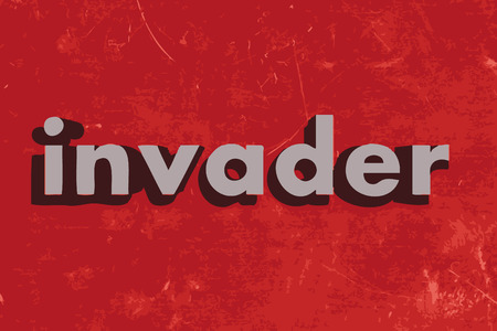 invader: invader word on red concrete wall