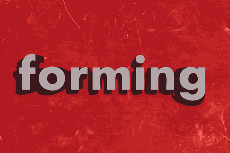forming: forming word on red concrete wall