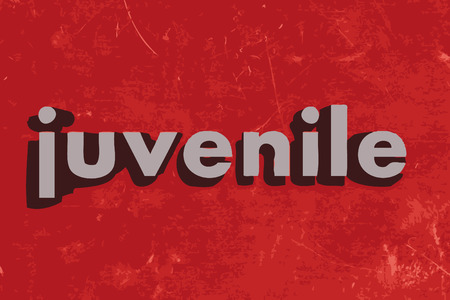 juvenile: juvenile word on red concrete wall