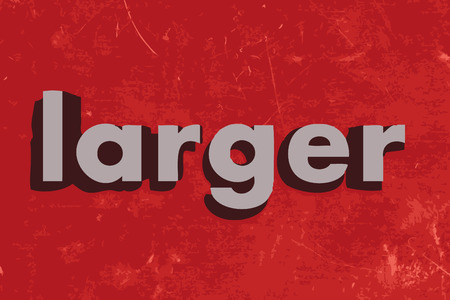 larger: larger word on red concrete wall