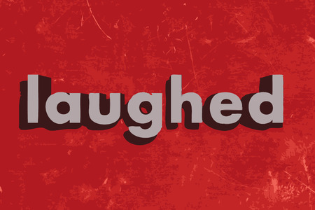 laughed word on red concrete wall
