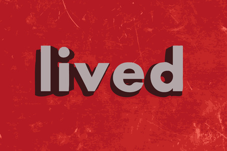 lived: lived word on red concrete wall
