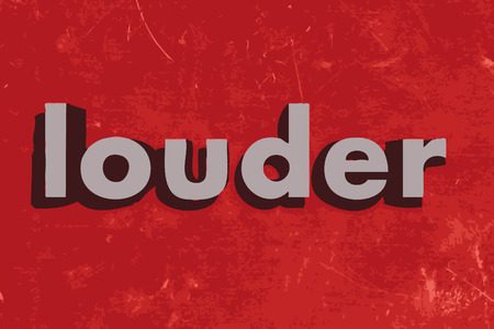 louder: louder word on red concrete wall
