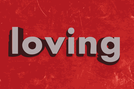 loving: loving word on red concrete wall