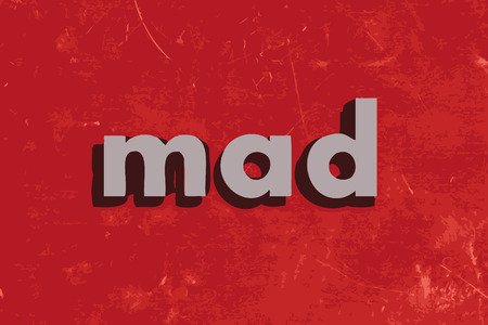 mad: mad word on red concrete wall