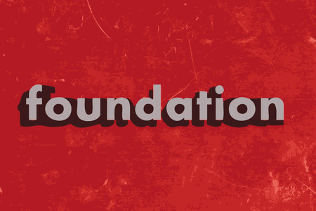 foundation: foundation word on red concrete wall