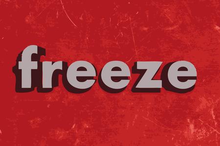 frieren: einfrieren Wort auf roten Betonwand