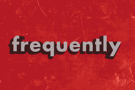 frequently: frequently word on red concrete wall