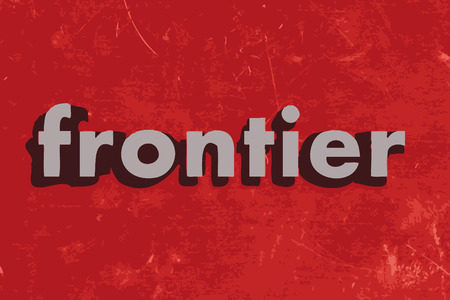frontier: frontier word on red concrete wall