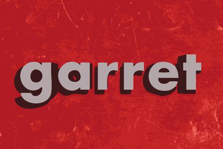 garret: garret word on red concrete wall
