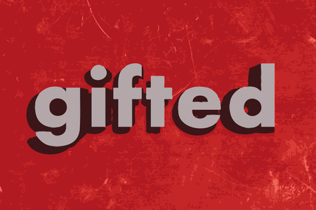 gifted: gifted word on red concrete wall