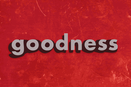 goedheid: goodness word on red concrete wall