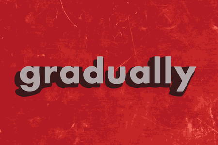 gradually: gradually word on red concrete wall