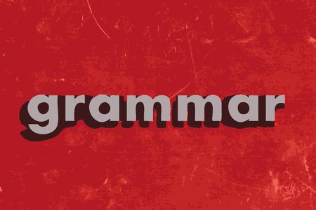 grammar: grammar word on red concrete wall
