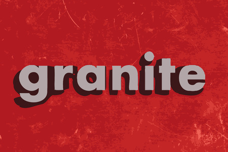 granite: granite word on red concrete wall