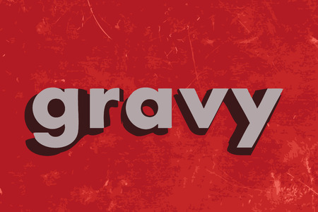 gravy: gravy word on red concrete wall