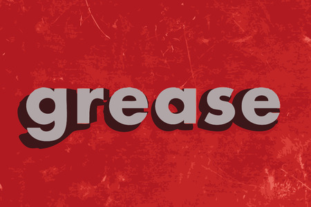 grease: grease word on red concrete wall