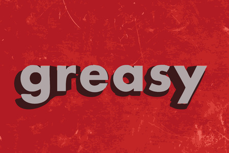 grease: greasy word on red concrete wall