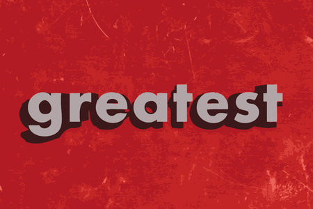 greatest: greatest word on red concrete wall