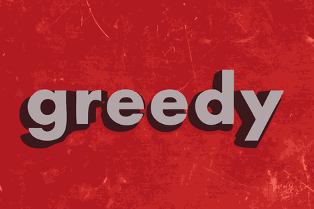 greed: greedy word on red concrete wall