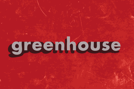 greenhouse: greenhouse word on red concrete wall