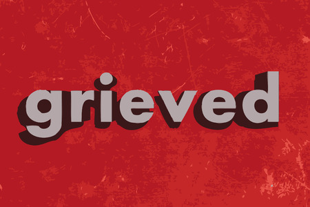grieved: grieved vector word on red concrete wall