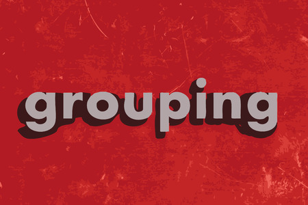 grouping: grouping word on red concrete wall