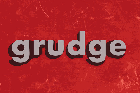 grudge: grudge word on red concrete wall