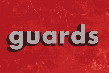 guards: guards word on red concrete wall