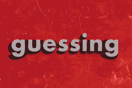 and guessing: guessing word on red concrete wall