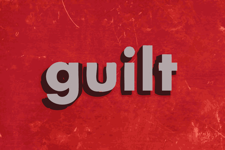 guilt: guilt word on red concrete wall